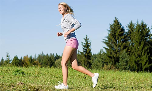 Smiling woman jogger